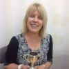 Sally Cox winning the Best Arts and Crafts cup for an Item of Embroidery