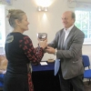 Sheila Sorby receiving the Polly Chiverton Cup from Judge Ray for the Finest Floral Arrangement - her Blue Theme