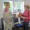 "Sheila presenting Lucy with the Best of Arts and Crafts Cup for her wooden ""Pig in a Pen"""