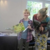 Hazel receiving her cup for the Best Children's hand-made card