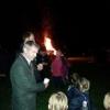 Village children enjoying the bonfire with Daddy