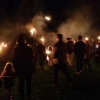 The first torches are thrown onto the bonfire