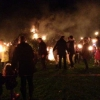 Even more torches are thrown onto the bonfire