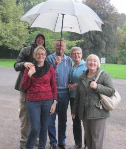 Waiting in the rain at the Village Hall