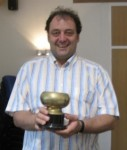 Wolfgang winning his cup for Best in Show for his man-made cake